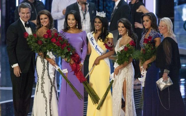 Nina Davuluri of New York poses with her court after being crowned Miss America 2014 at Boardwalk Hall in Atlantic City September 15, 2013. (L-R) Miss America CEO Sam Haskell, Kelsey Griswold of Oklahoma (2nd runner-up), Crystal Lee of California (1st runner up), Myrrhanda Jones of Florida (3rd runner-up) and Rebecca Yeh of Minnesota (4th runner-up), and far right is Sharon Pearce, President of the Miss America Pageant. UPI/John Anderson